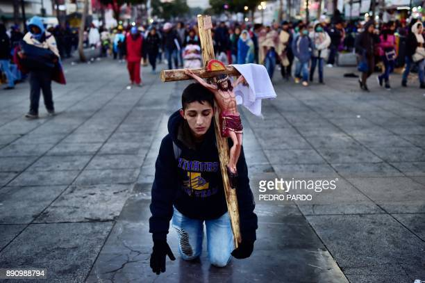 TOPSHOT A penitent pays a promise during the feast of the Virgin of Guadalupe patron saint of Mexico in Mexico City on December 12 2017 Millions of...