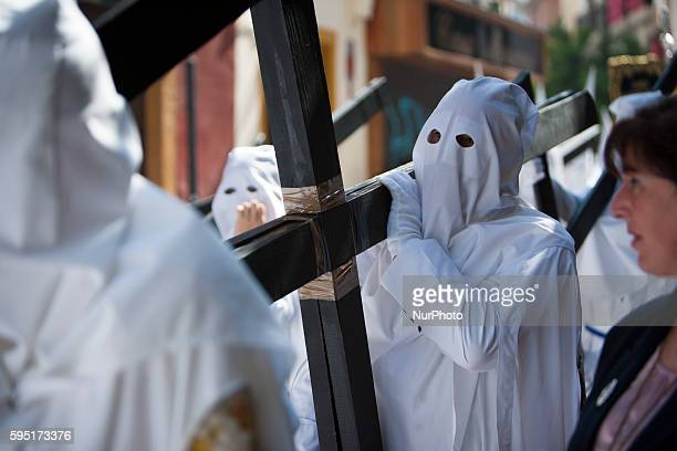 A penitent quotnazarenoquot of the Brotherhood called quotLa Pazquot during its parade to Cathedral on Sunday of Palms day called Domingo de Ramos in...