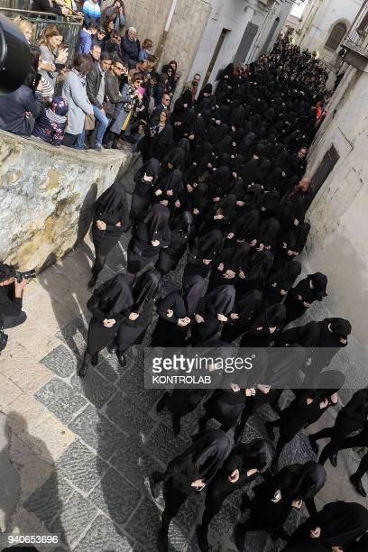 Penitent women dressed in black walk and sing Catholic music during the procession called Desolata in Canosa di Puglia southern Italy on Holy...
