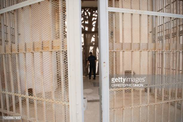 A penitentiary guard patrols in the women section as French Justice Minister visits les baumettes penitentiary on October 26 2018 in Marseille...
