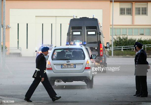 A penitentiary police van carries Ivorian citizen Rudy Hermann Guede to Perugia's jail 06 December 2007 after being extradited from Germany where he...