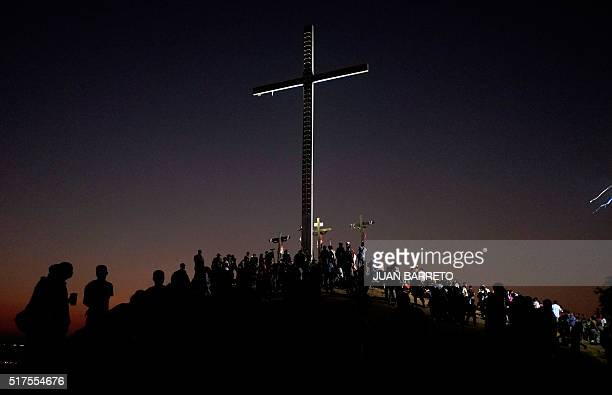 TOPSHOT Penitents and pilgrims during the procession for the Passion of Jesus Christ on Good Friday in the lowincome neighbourhood of Petare in...