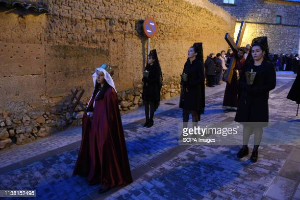 Penitents are seen during the procession of 'Viernes Santo' in Soria north of Spain More than one billion Christian across the world mark the Holy...