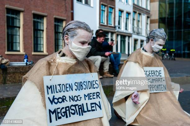 Penitents are seen on their knees during the demonstration. As a part of the Spring Rebellion campaign of Extinction Rebellion, artist performance...