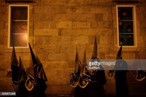 Penitents attend the Oraci��n del huerto y prendimiento brotherhood procession in Santiago during the Holy Week on March 31 2015