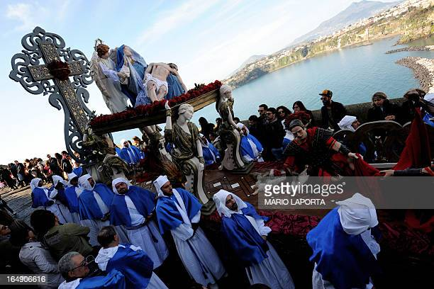 Penitents carry a sculpture depicting the deposition of Christ during a procession for Good Friday on the southern island of Procida in Naples' gulf...
