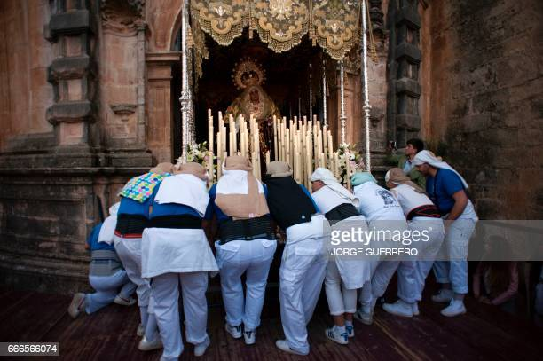 "Penitents carry a statue of the ""Maria Santisima de la Amargura's Virgin"" during the ""Gitanos"" brotherhood procession on April 9, 2017 in Ronda,..."