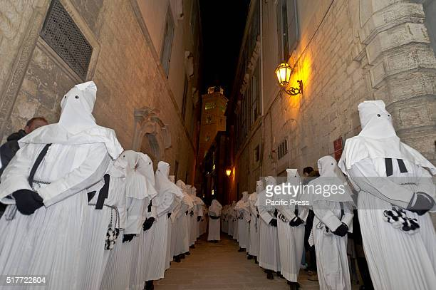 Penitents during Good Friday procession of Virgin Mary