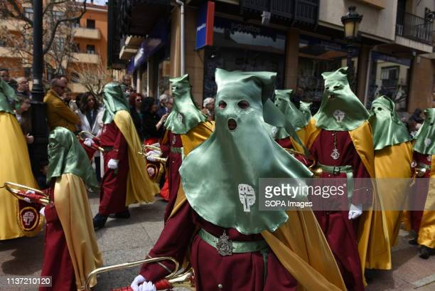 Penitents from 'Entrada de Jesús en Jerusalen' brotherhood are seen during the procession of 'Domingo de Ramos' in Soria north of Spain Palm Sunday...