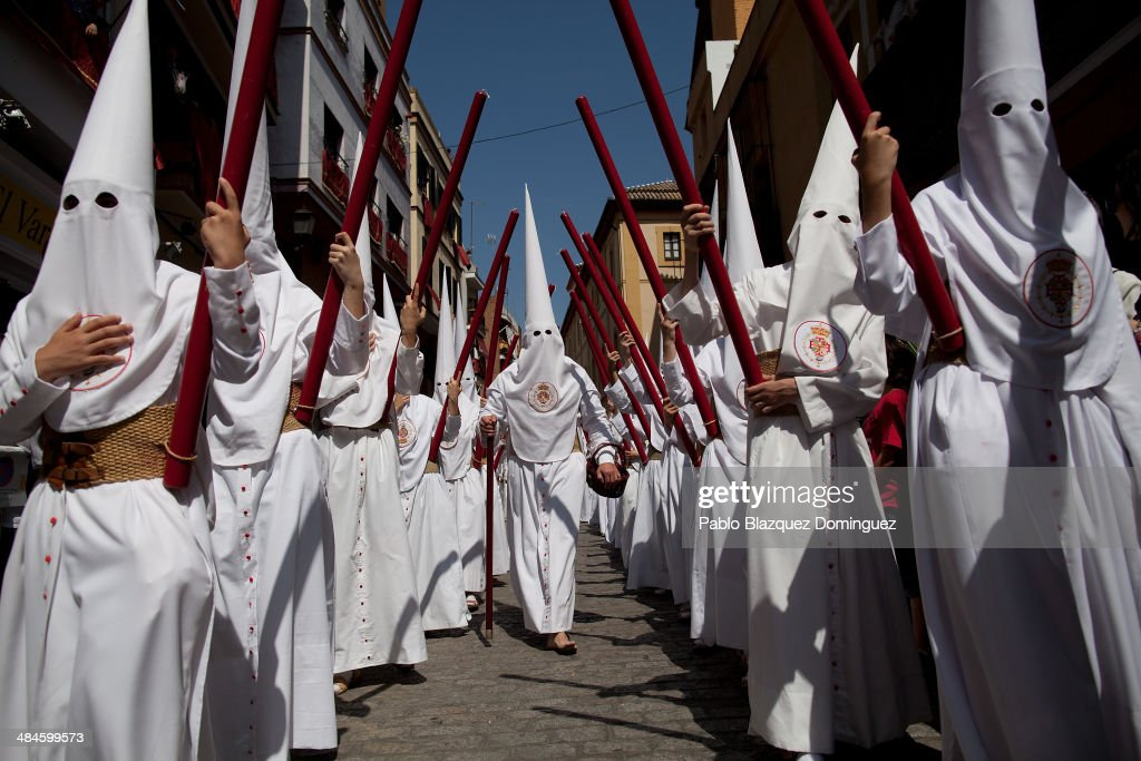 Penitents from 'La Cena' brotherhood walk during a procession on April 13, 2014 in Seville, Spain. Easter week is traditionally celebrated with processions in most Spanish towns.