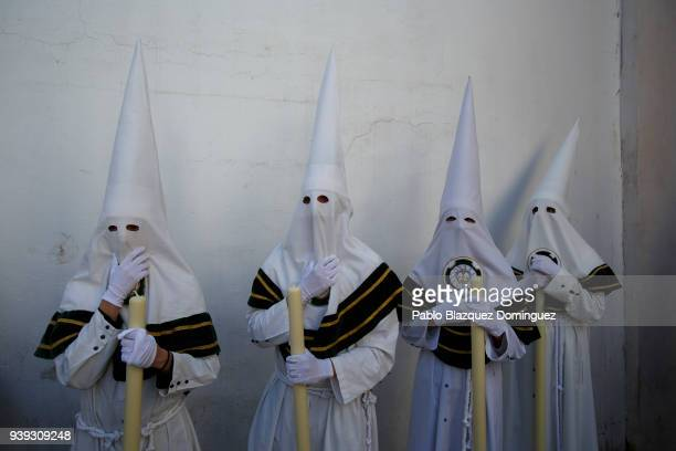 Penitents from La Paz brotherhood take part in a procession during Easter Wednesday on March 28, 2018 in Cordoba, Spain. Spain celebrates the holy...