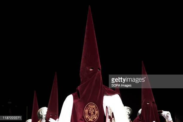 Penitents from Maravillas brotherhood are seen exiting from church during the Palm Sunday procession in Granada Every year thousands of Christian...