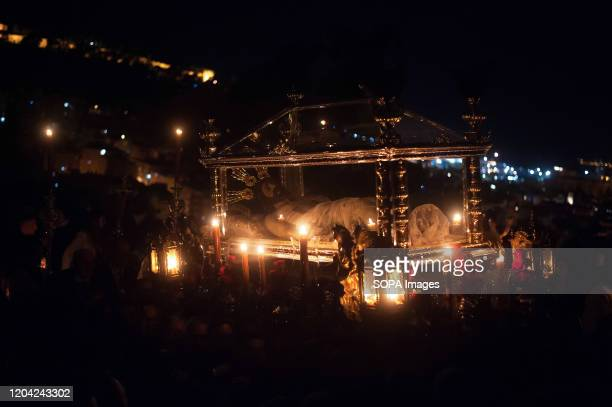 Penitents from Monte Calvario brotherhood carry a statue of Christ as they take part during the Stations of the Torches. Each year after the start of...