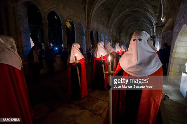 Penitents from the Brotherhood of the holy burial take part in the procession of the holy mercy inside the cloister of the cathedral of Santander on...