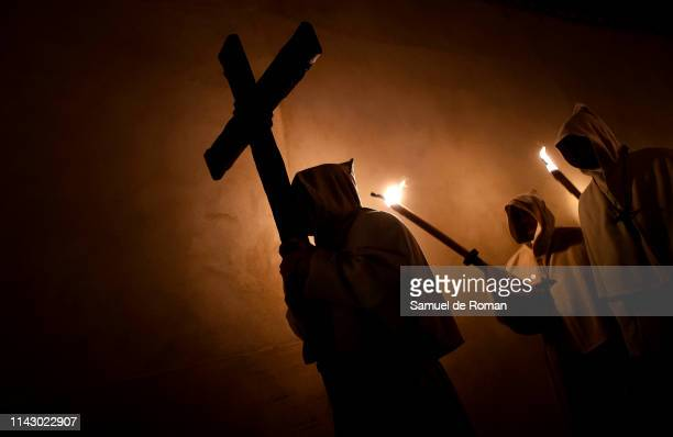 Penitents from the Cristo de la Buena Muerte brotherhood take part in a procession in the early hours of the morning on April 16, 2019 in Zamora,...