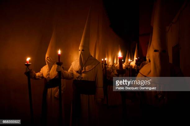 Penitents from the 'Jesus Yacente' brotherhood take part in a procession on April 13 2017 in Zamora Spain Spain celebrates holy week before Easter...