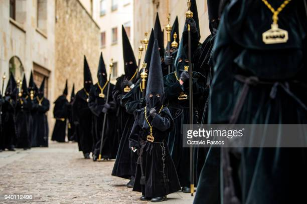 Penitents from the 'La Real Cofradia del Santo Entierro de Zamora' brotherhood take part in a procession on March 30 2018 in Zamora Spain The Holy...