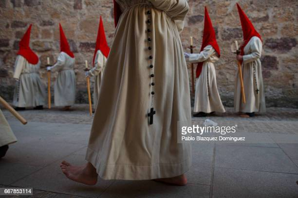 Penitents from the Santisimo Cristo de las Injurias brotherhood take part in the procession of the Silence outside Zamora's Cathedral on April 12...
