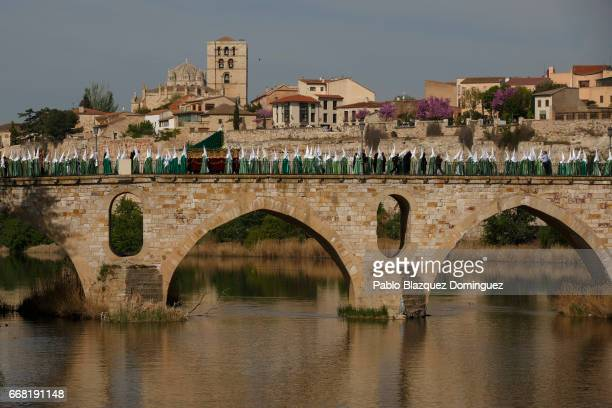 Penitents from the Virgen de la Esperanza brotherhood take part in a procession on April 13, 2017 in Zamora, Spain. Spain celebrates holy week before...