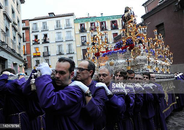 Penitents leave San Pedro church carrying a statue depecting 'Jesus the Poor ' during a Holy Week procession on April 5 2012 in Madrid Christian...