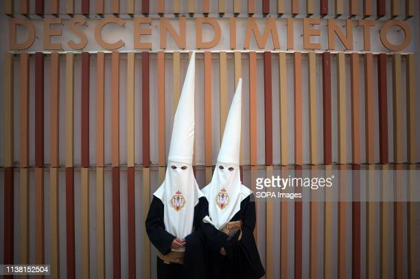 Penitents of 'Descendimiento' brotherhood are seen outside their brotherhood before taking part in the holy week procession. The Holy Week in...
