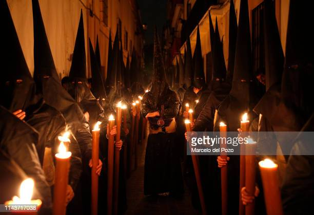 Penitents of El Gran Poder brotherhood take part in a procession during Holy Week on April 19 2019 in Seville Spain 'Holy Week' or 'Semana Santa'...