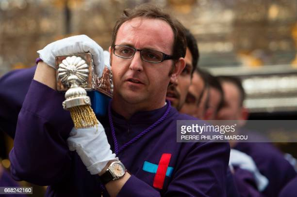 """Penitents of """"Jesus the Poor"""" brotherhood take part in a procession in Madrid during the Holy Week on April 13, 2017. Christian believers around the..."""