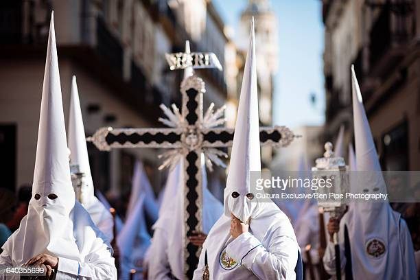Penitents of Los Negritos Brotherhood taking part in processions during Semana Santa (Holy Week), Seville, Andalucia, Spain