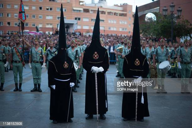 Penitents of 'Mena' brotherhood are seen taking part during the holy week procession. The Holy Week in Andalusia is one of the most important and...