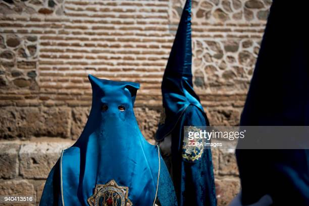 Penitents of Santa María de la Alhambra brotherhood before taking part in the Holy Saturday Procession in Granada Every year thousands of christians...