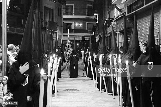 Penitents of the Hermandad de la Pasión in procession on Good Friday, during the Semana Santa in Sevilla, Spain. Christian believers around the world...