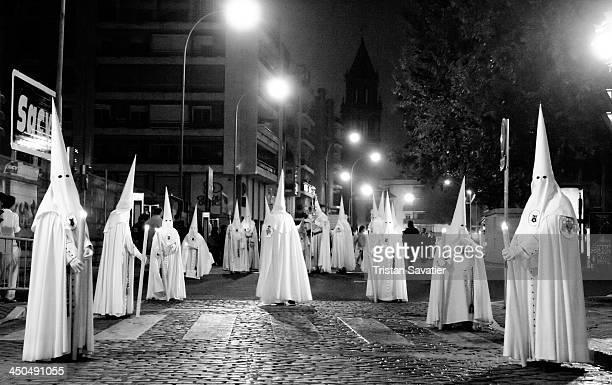 Penitents of the Hermandad de la Resurrección in procession on Palm Sunday, during the Semana Santa in Sevilla, Spain. Christian believers around the...