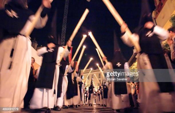 Penitents of the Hermandad de la Soledad de San Lorenzo in procession on Holy Saturday, during the Semana Santa in Sevilla, Spain. Christian...