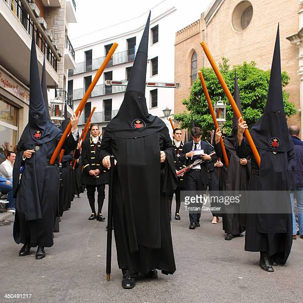 Penitents of the Hermandad de los Servitas in procession on Holy Saturday, during the Semana Santa in Sevilla, Spain. Christian believers around the...