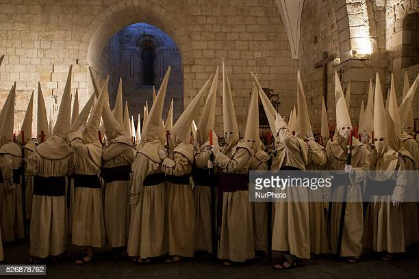 Penitents of the Jesus Yacente brotherhood take part in a procession in the early morning of Holy Friday in Zamora Spain March 25 2016 Hundreds of...