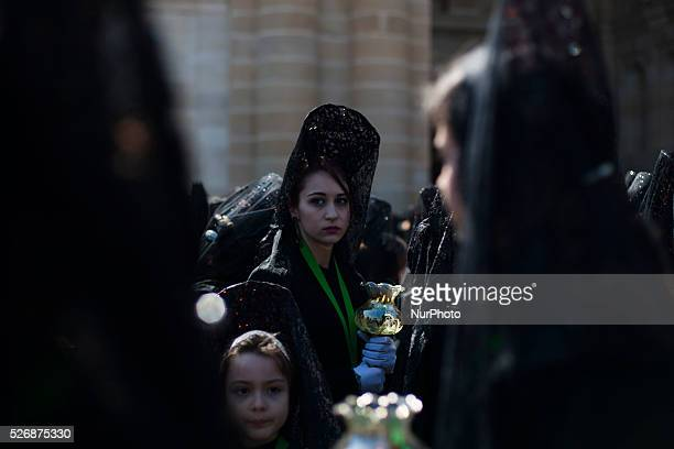 Penitents of the quotDamas de la Esperanzaquot brotherhood take part in the procession of Holy Thursday on 24th March 2016 in Zamora Spain Women...