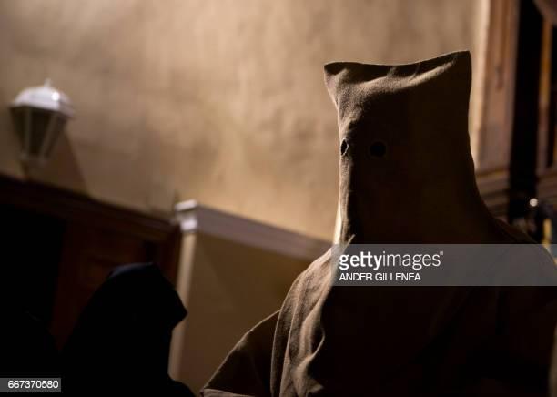 Penitents of the 'Silencio del Santisimo Cristo del Rebate' brotherhood, called 'Ensacado' because of the bag like cover shief, take part during a...