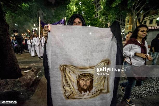 Penitents participate in the Procession of the Dead Lord at the Metropolitan Cathedral on the afternoon of Good Friday on April 14 2017 in Sao Paulo...