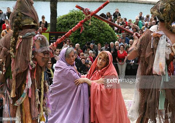 Penitents perform during the reenacting of The Via Crucis in Palma de Mallorca on April 10 2009 Christian believers around the world mark the Holy...