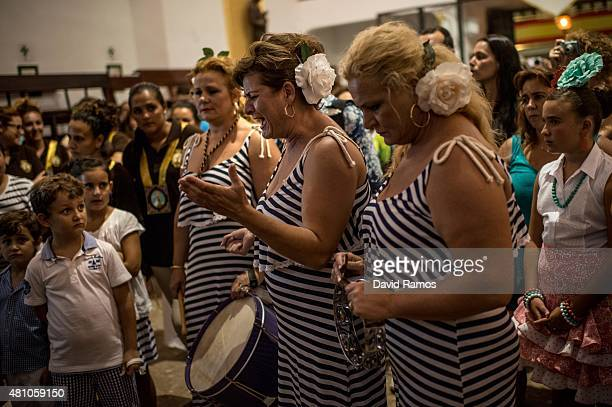 Penitents sing a 'Saeta' during a flower offering to the Virgen del Carmen on July 15 2015 in Torremolinos Spain Every year since late 19th century...