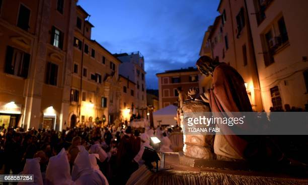 Penitents take part in a Good Friday procession in Civitavecchia, north of Rome, on April 14, 2017. Good Friday is the second of four important days...