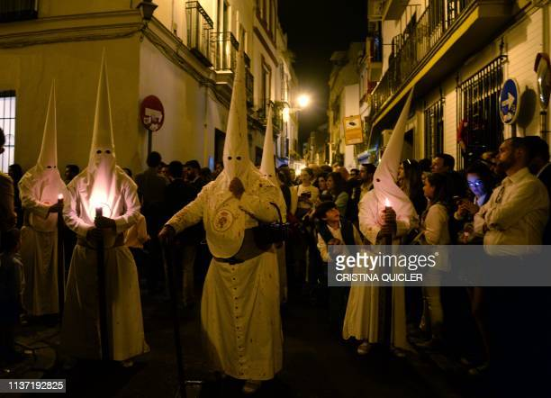 TOPSHOT Penitents take part in 'La Cena' brotherhood Palm Sunday procession in Sevilla on April 14 during the Holy Week Christian believers around...