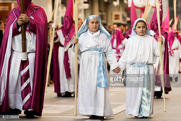 Penitents take part in Palm Sunday procession that commemorates the triumphal entry of Jesus into Jerusalem riding on a donkey in Zamora Spain on...