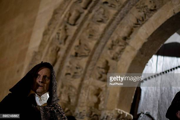 Penitents take part in the Capas Pardas procession of the quotCristo del Amparoquot brotherhood The brothers wear the typical Aliste shepherd's...