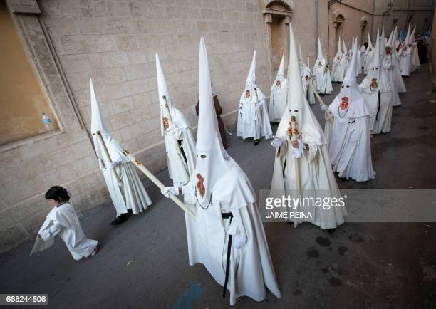 Penitents take part in the Cristo de la sangre procession during Holy Week celebrations in Palma de Mallorca on April 13 2017 Christian believers...
