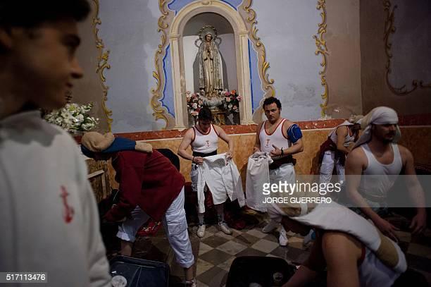 Penitents take part in the 'Jesus de las Tres Caidas y Nuestra Senora del Rosario' brotherhood procession on March 23 2016 in Granada during the Holy...