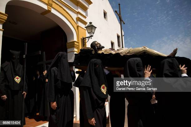 Penitents take part in the Monte Calvario brotherhood procession during Holy Week on April 14 2017 in Malaga Spain Christian believers around the...