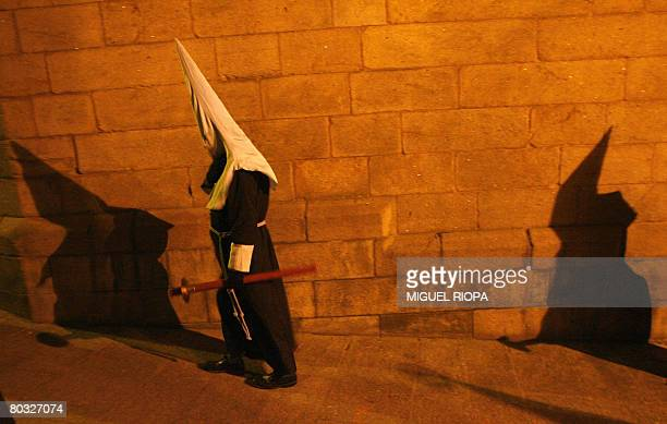 """Penitents take part in the """"Nuestro Padre Jesus Flagelado"""" brotherhood procession in the streets of the historical city of Santiago de Compostela,..."""