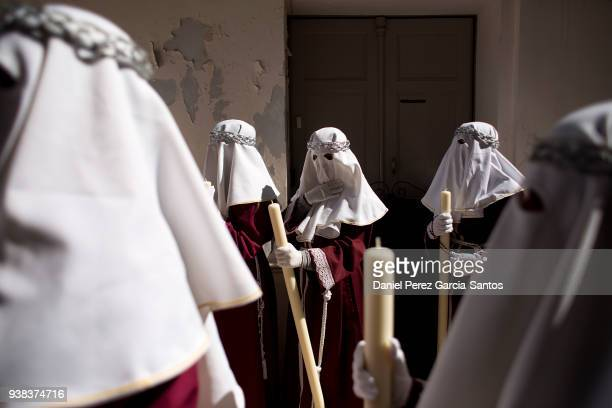 Penitents take part in the procession of los Gitanos brotherhood during Holy Week on March 26, 2018 in Malaga, Spain. Christian believers around the...