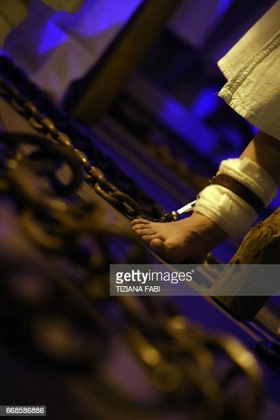 Penitents walk barefoot and chained during a Good Friday procession in Civitavecchia, north of Rome, on April 14, 2017. Good Friday is the second of...